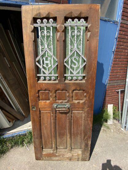 LEEN_Oude bouwmaterialen_Antieke voordeur met gietijzeren roosters E24199