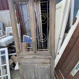 LEEN_Oude bouwmaterialen_Antieke voordeur met gietijzeren rooster H67483