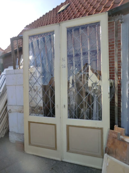 LEEN_Oude bouwmaterialen_Kamer en suite schuifdeuren met glas in lood  100.30.102270